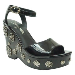 CHANEL Black Patent Wedge with Metal Camellias - 37.5