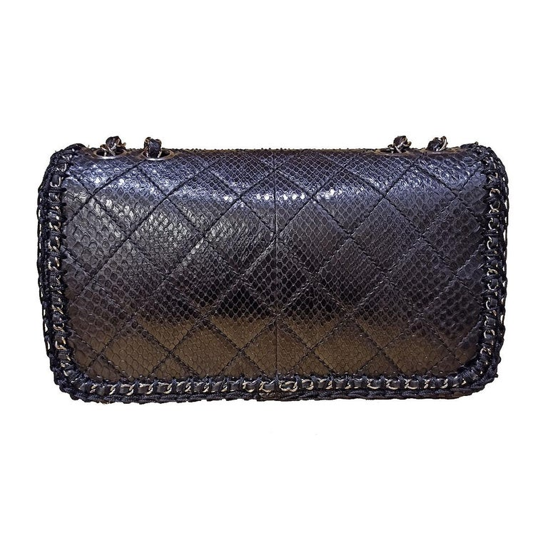Fantastic and iconic Chanel bag  Year 2006/2008 Real python leather Black color Silver hardware Worked wool sides Internal pocket and phone holder No card Serial number inside Cm 26 x 15 x 8 (10.2 x 5.9 x 3.14 inches) With dustbag and box Perfect