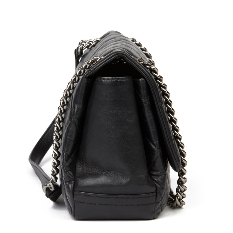 CHANEL Black Quilted Aged Calfskin Leather Jumbo Lady Pearly Flap Bag  Xupes Reference: HB3430 Serial Number: 16883247 Age (Circa): 2012 Accompanied By: Chanel Dust Bag, Authenticity Card, Invoice Authenticity Details: Authenticity Card, Serial