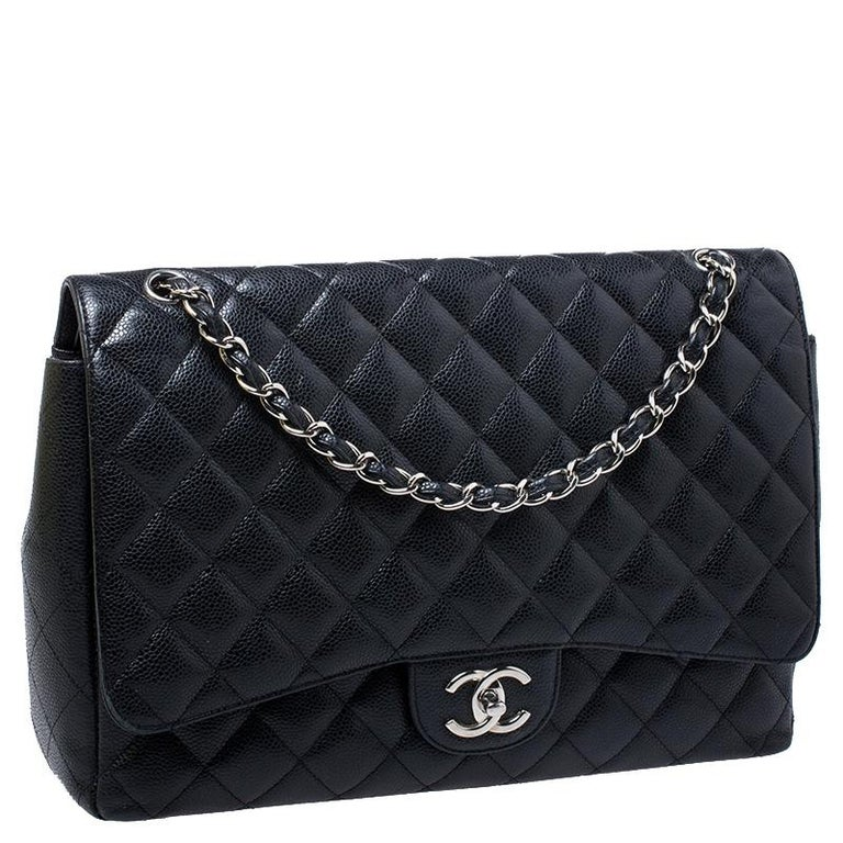 Chanel Black Quilted Caviar Leather Maxi Classic Double Flap Bag In Good Condition For Sale In Dubai, Al Qouz 2