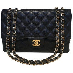 Chanel Black Quilted Caviar Leather Maxi Classic Flap Shoulder Bag