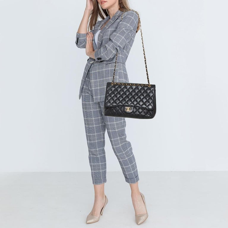We are in utter awe of this flap bag from Chanel as it is appealing in a surreal way. Exquisitely crafted from caviar leather in a quilted design, it bears the signature label on the leather interior and the iconic CC turn-lock on the flap. The