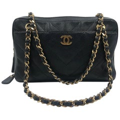 Chanel Purse Black Chevron Quilted Caviar Leather with Shoulder Strap