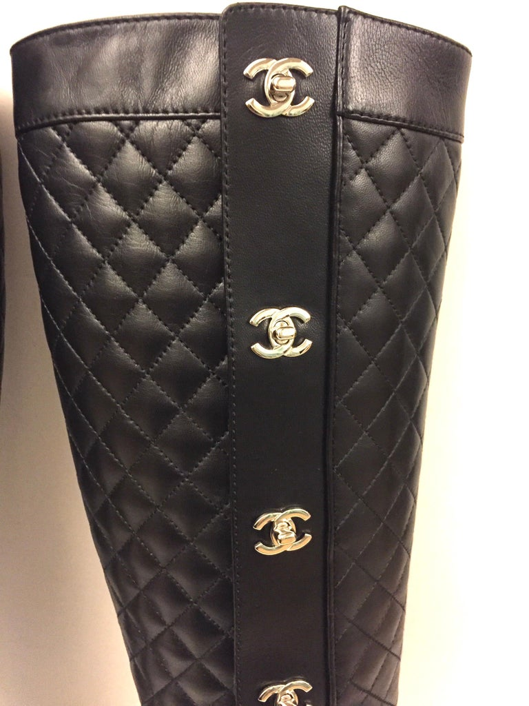"""- Chanel black quilted lambskin long boots with silver """"CC"""".   - Zip closure on the side.   - Size: 36.5.  - Height:  43cm height, with 4cm heels."""