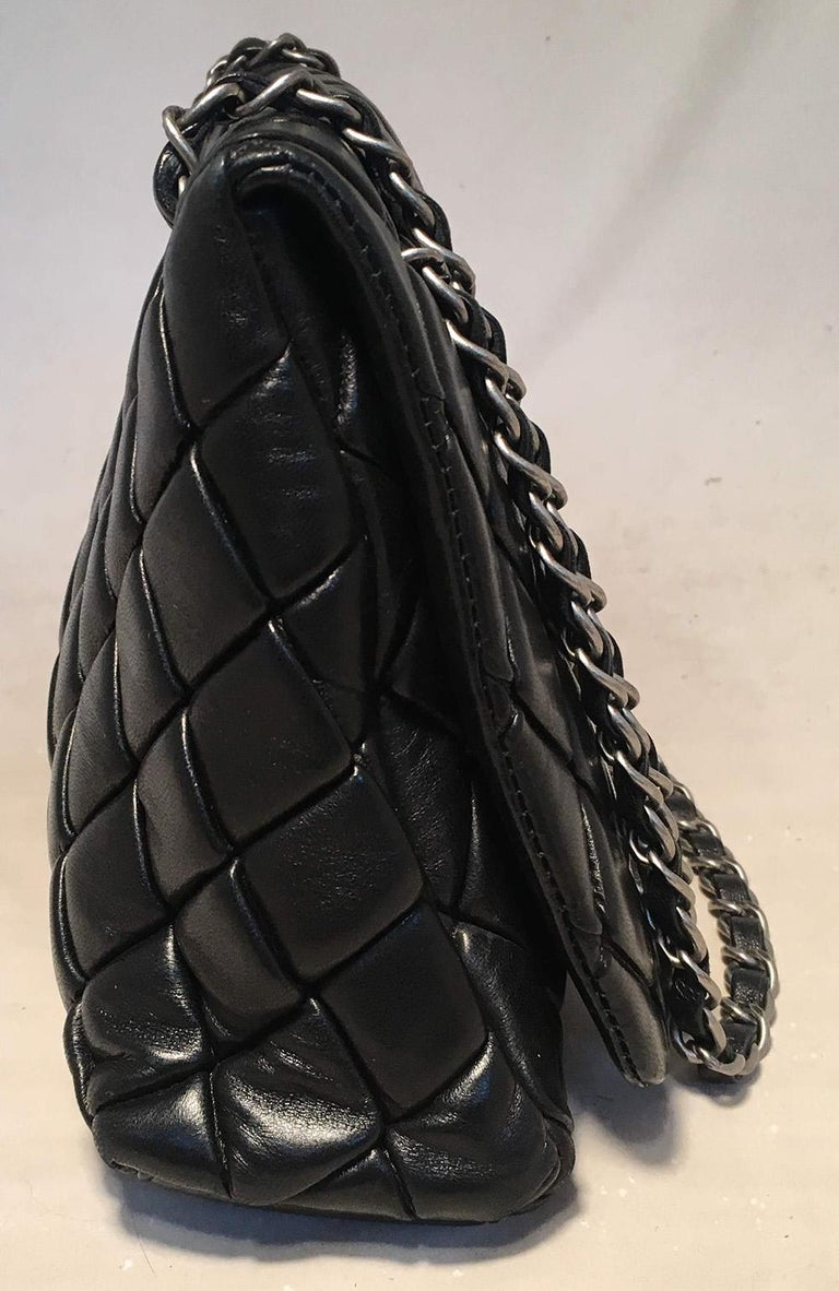 Chanel Black Quilted Lambskin Classic Flap Maxi Shoulder Bag in excellent condition. Black soft lambskin leather quilted in the signature diamond pattern. antiqued silver hardware and woven chain and leather shoulder strap that can be worn doubled