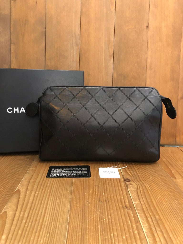 Authentic Chanel Clutch in dark navy quilted Lambskin. Interior fully refurbished by Chanel store. Original tags preserved but serial sticker removed. Comes with original Chanel box.  Material: Lambskin leather  Color: Black Origin: France