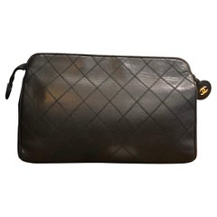 CHANEL Black Quilted Lambskin Leather Clutch Bag