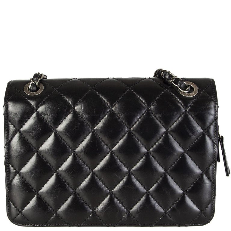 Black CHANEL black quilted lambskin leather DAY TRIP FLAP Shoulder Bag