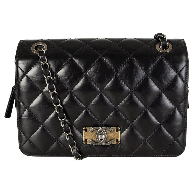 CHANEL black quilted lambskin leather DAY TRIP FLAP Shoulder Bag