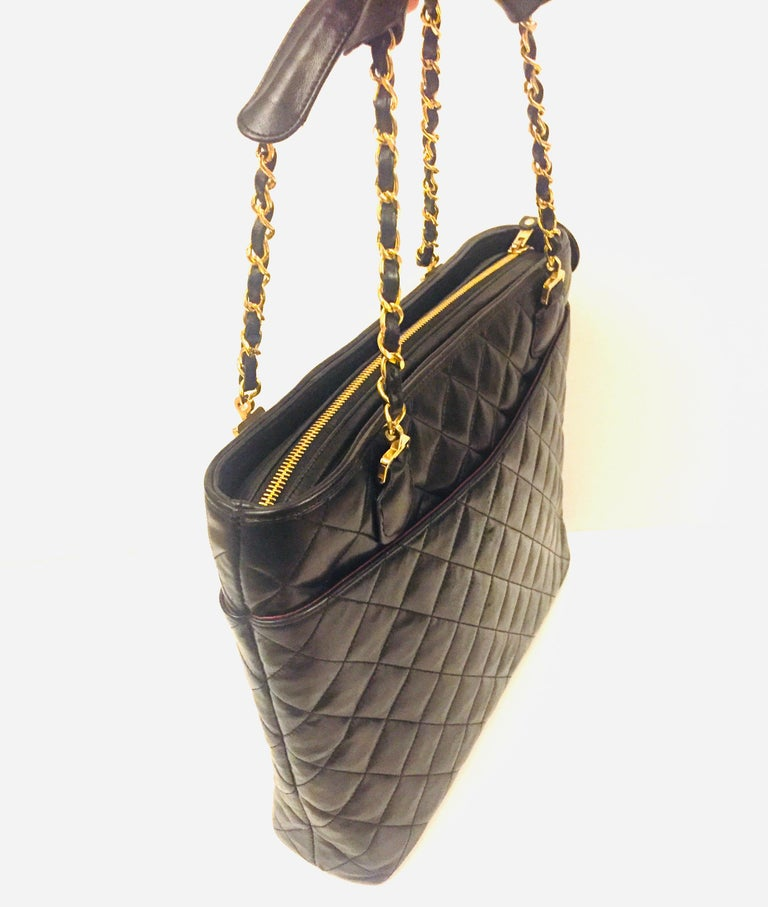 - Vintage 80s Chanel black quilted lambskin leather tote bag.    -