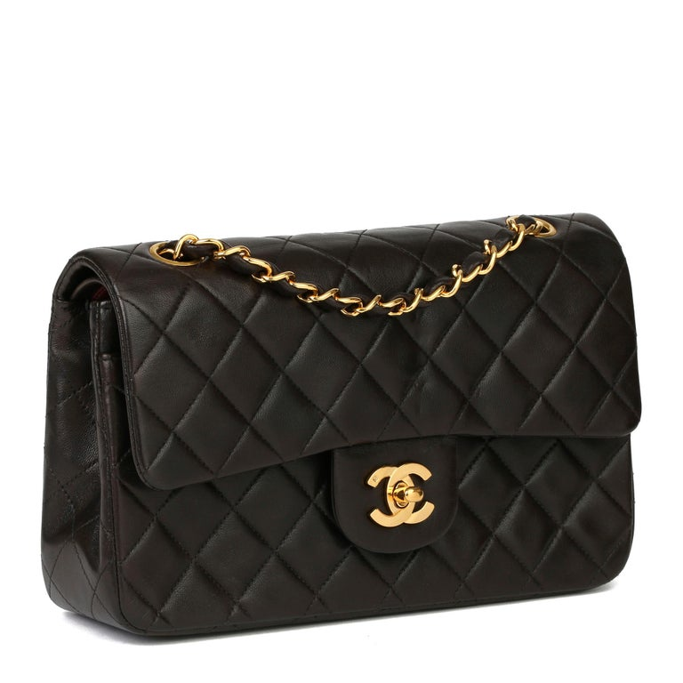 CHANEL Black Quilted Lambskin Leather Vintage Small Classic Double Flap Bag  Xupes Reference: HB3927 Serial Number: 2604733 Age (Circa): 1994 Accompanied By: Chanel Dust Bag Authenticity Details: Serial Sticker (Made in France) Gender: Ladies Type: