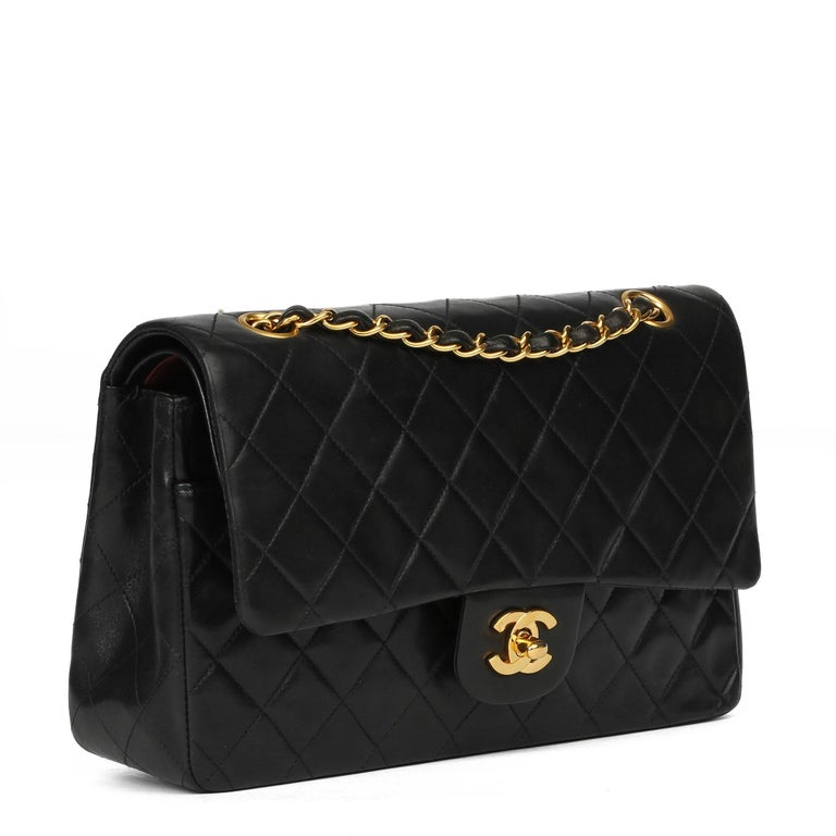 CHANEL Black Quilted Lambskin Vintage Medium Classic Double Flap Bag  Xupes Reference: HB3937 Serial Number: 4567300 Age (Circa): 1997 Accompanied By: Chanel Dust Bag Authenticity Details: Serial Sticker (Made in France) Gender: Ladies Type:
