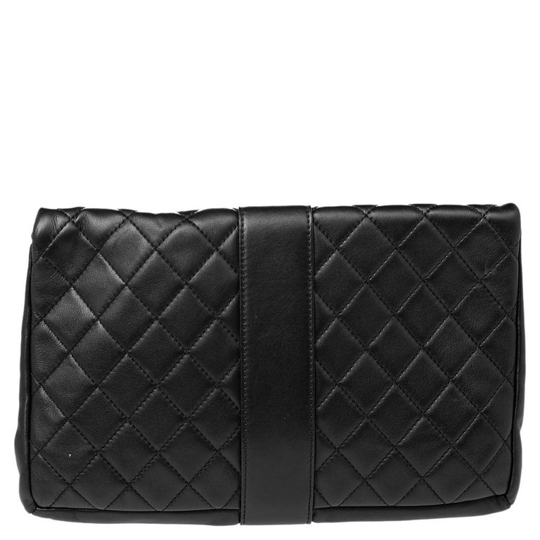 The Chanel Grip clutch, beautifully crafted using black leather, offers a classic style. It has a quilted flap secured with a belted strap, and the interior is lined with canvas.  Includes: Original Dustbag, Authenticity Card