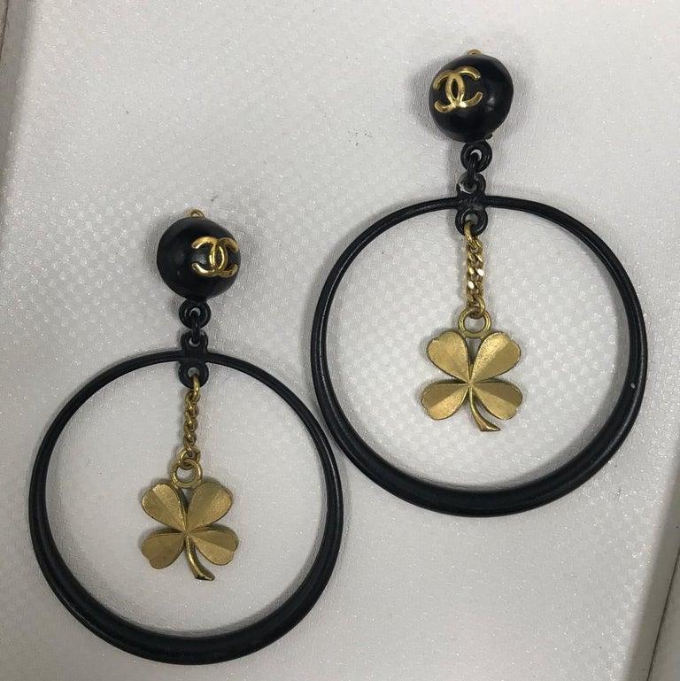 Chanel - Rare Vintage Clover Dangle Hoop Earrings clip on style gold tone hardware cutout hoop at drop cc logo at hoop light wear throughout  Hoop Diameter: 2.75