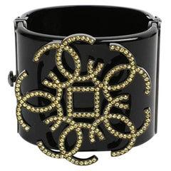 Chanel Black Resin Cuff With CC Logo Yellow Rhinestones