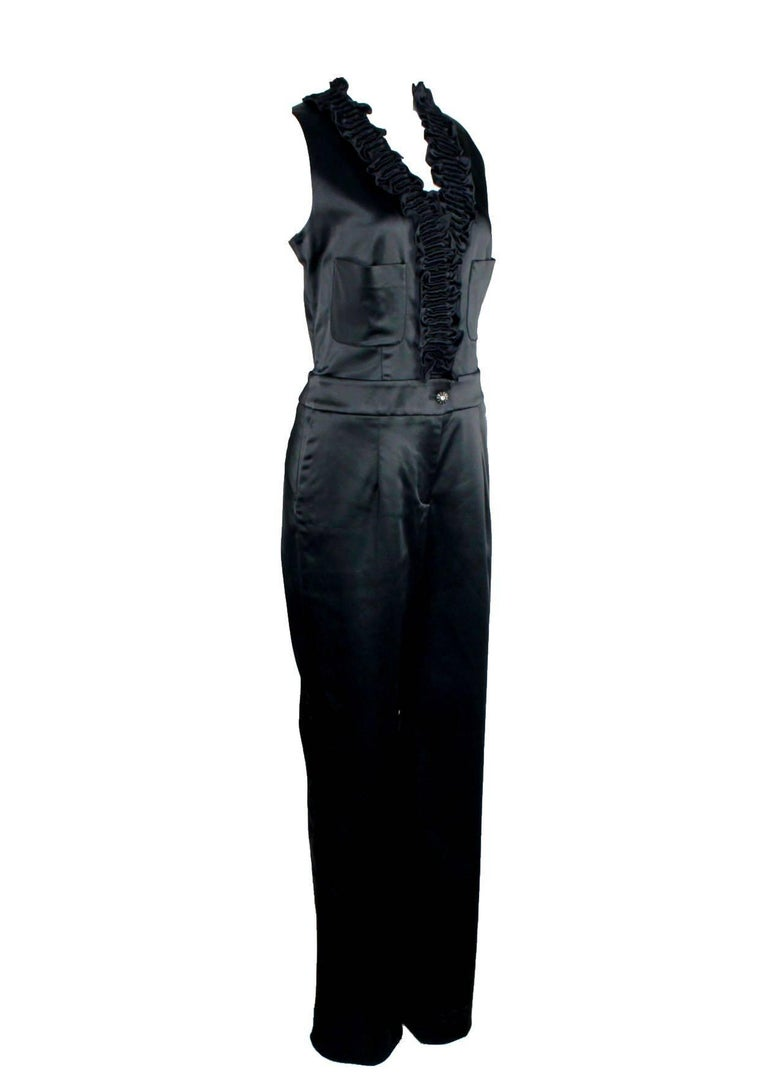 Chanel's tuxedo jumpsuit is a modern take on tailoring. Cover up by day with a cropped jacket, adding a sculpting waist belt and platform heels for an impeccably sharp after-dark silhouette.  Stunning Chanel jumpsuit A signature piece that will last