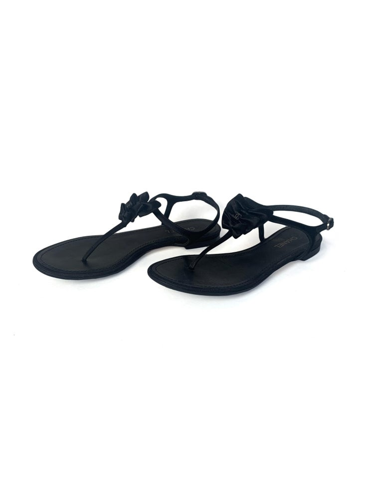 Chanel Black Satin Bow Thong Sandals.  Features three bows with black crystal CC, and crystal encrusted buckle.  Made In: Italy Year of Production: 2013 Color: Black Hardware: Gunmetal Materials: Satin, crystal, grosgrain Closure/Opening: Adjustable