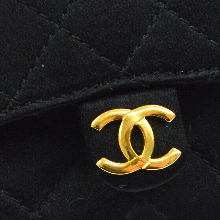 Chanel Black Satin Gold Small Micro Mini Party Evening Crossbody Shoulder Flap Bag  Satin Leather Gold tone hardware Woven lining Snap closure Made in France Shoulder strap drop 20