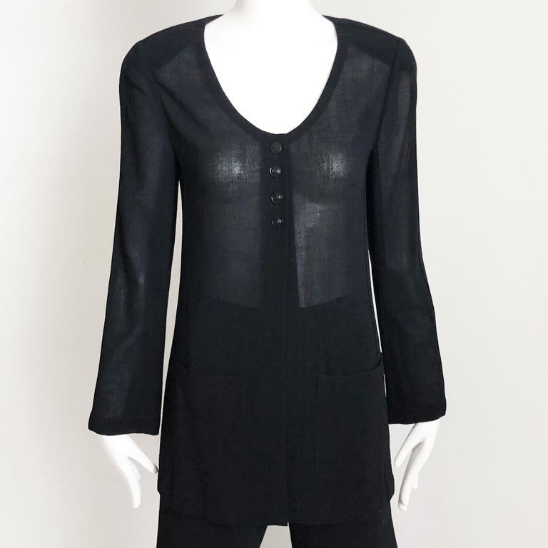 Chanel Black Sheer Wool Crepe Jacket and Pant Suit 2pc circa 1999. Jacket is sheer and unlined w/chain at hem; pant is lined in silk. Preowned/vintage with some signs of wear: jacket has a replacement Chanel button on the top (see last two images).
