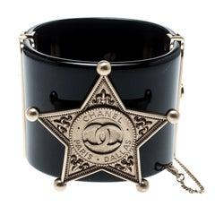 Chanel Black Sheriff Star Gold Tone Wide Cuff Bracelet