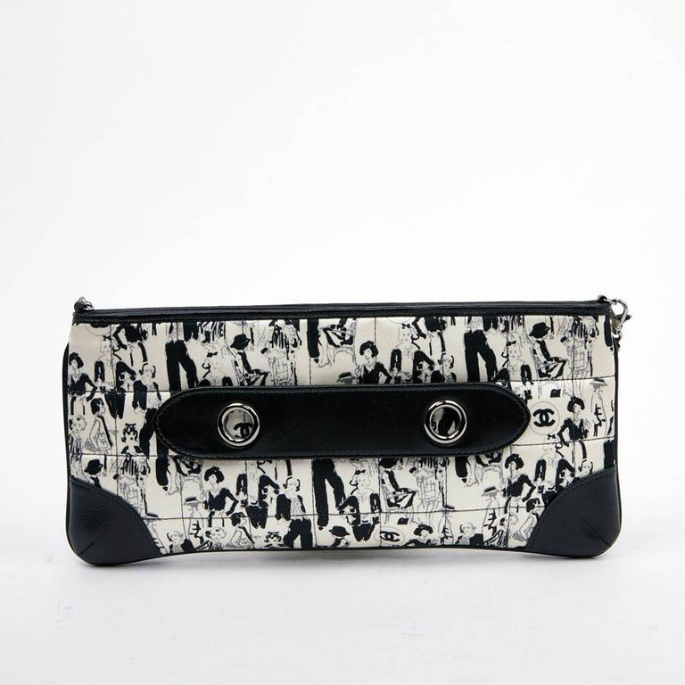 CHANEL black silk clutch with removable scarf. This CHANEL clutch is in black and white silk is quilted with character decoration (Coco Chanel) and black leather on the corners. The jewelry is palladium silver. It can be worn on the shoulder or