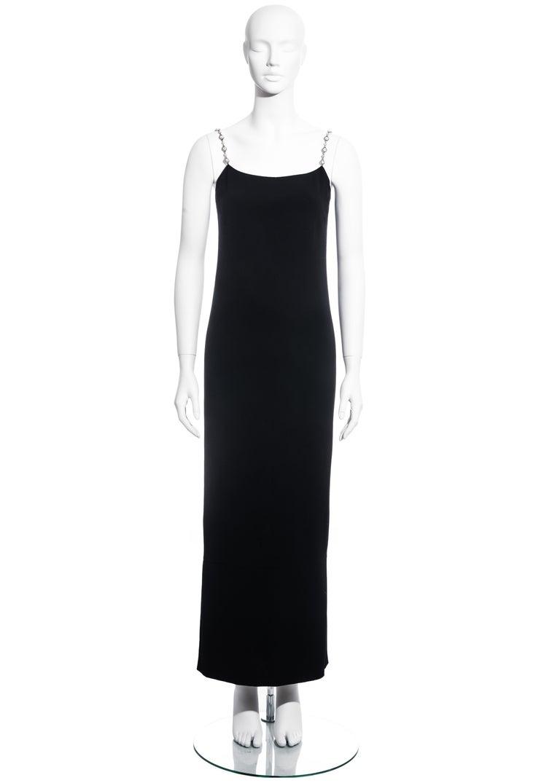 ▪ Chanel black evening column dress ▪ 100% Silk  ▪ Designed by Karl Lagerfeld ▪ Crystal and silver metal chain shoulder straps ▪ Scoop neckline  ▪ Zip back fastening  ▪ FR 36 - UK 8 - US 4 ▪ Spring-Summer 1998