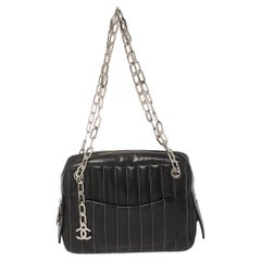Chanel Black Vertical Quilted Leather Mademoiselle Camera Bag