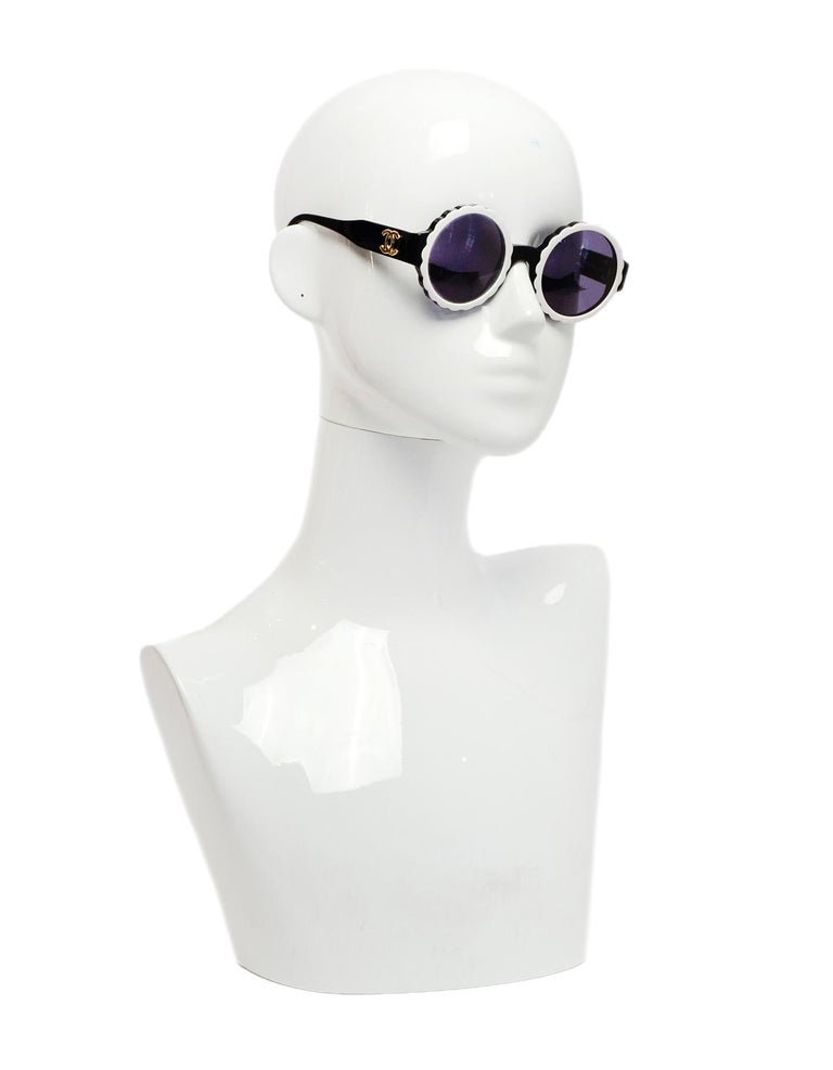 Chanel Black/White Acetate Scalloped Round Sunglasses  Made In: Italy Year of Production: 1994 Color: Black, white Hardware: Goldtone hardware Materials: Acetate Overall Condition: Very good pre-owned condition, with minor wear throughout and