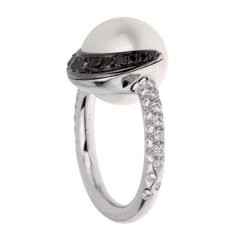 A fabulous Chanel diamond ring circa 2000s adorned with round brilliant cut diamonds, and round brilliant cut diamonds encasing the pearl set in platinum.  Resizeable