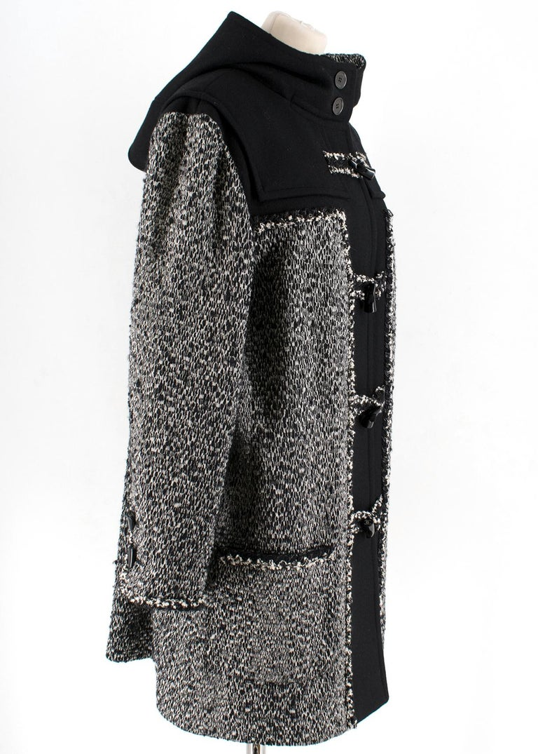 Chanel Black & White Tweed Knit Wool Blend Hooded Coat  -Black with white tweed -Wool blend -Horn toggle closure -Functional front pockets -100% silk double lining -Attached hood  Please note, these items are pre-owned and may show some signs of