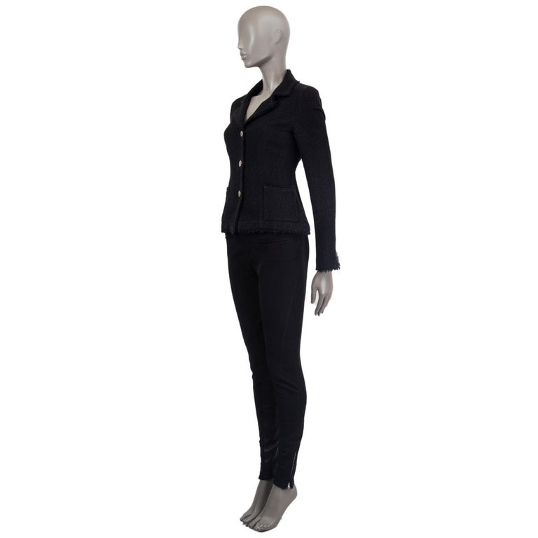 Chanel three-button blazer in black wool (86%) and silk (14%) with two patch pockets on the front. Silver-tone CC buttons, fringed trims and CC chain-cufflinks. Lined in silk (with 5% elastane). Has been worn and is in excellent condition.  Tag Size