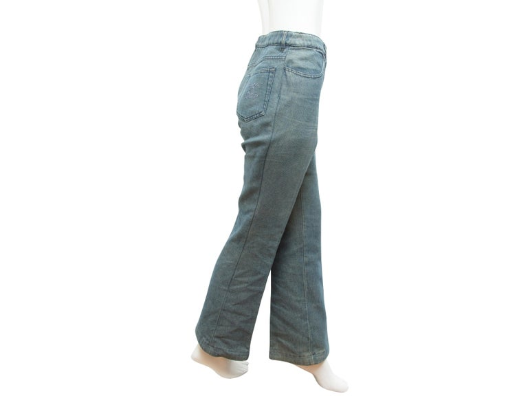 Product details:  Blue jeans by Chanel.   Banded waist with belt loops.  Button and zip fly closure.  Five-pocket design.  Crystal-encrusted logo detail on back pocket.  Slightly flared leg opening.  30