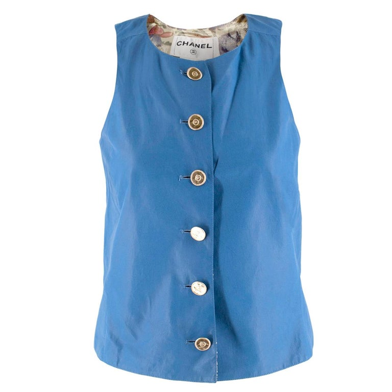 Chanel Blue Lambskin Vest  - Lightweight sky blue lambskin vest - Silk-blend metallic floral lining - Gold-tone coin inspired buttons with CC in the centre  Please note, these items are pre-owned and may show some signs of storage, even when unworn