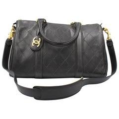 Chanel Boston handbag in black leather – travel bag