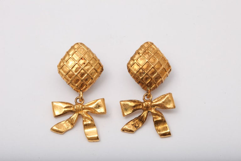 Chanel earrings with Chanel's iconic quilted details and bows. Stamped Chanel Made in France.