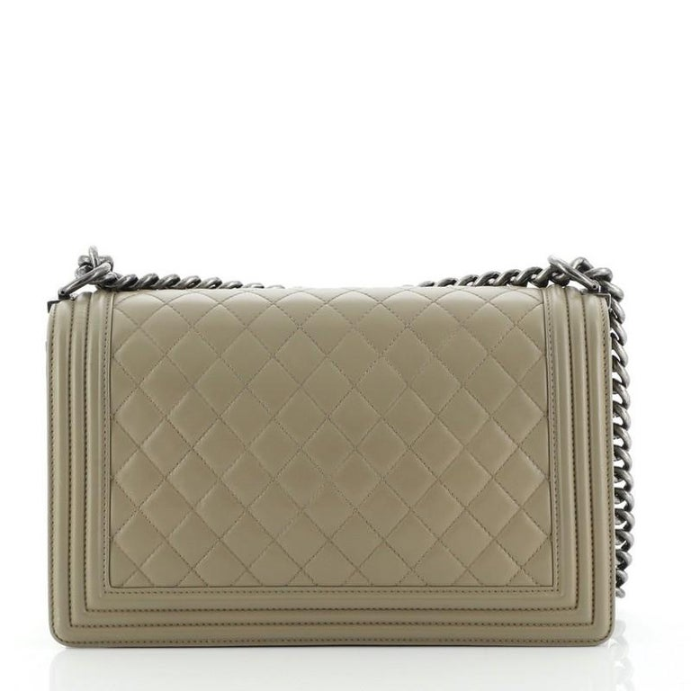 Chanel  Boy Flap Bag Quilted Lambskin New Medium In Fair Condition For Sale In New York, NY