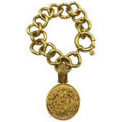 Chanel CC Logo Bracelet Gold Tone Filigree with a Hanging CC Medallion