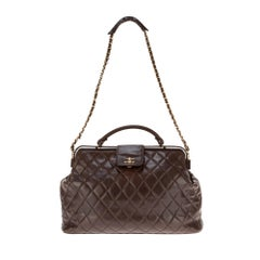 Chanel briefcase style handbag in brown quilted lambskin !
