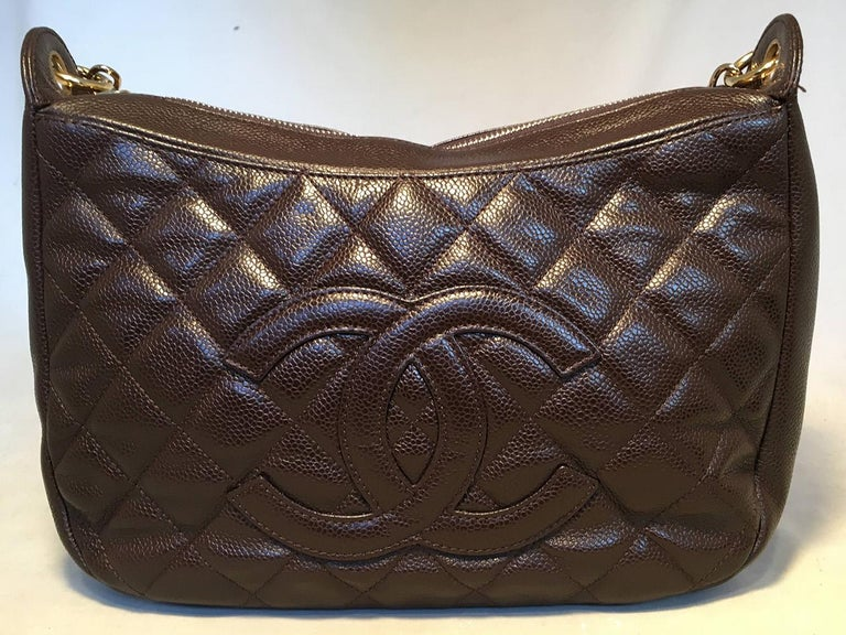 Chanel Brown Caviar Quilted Crescent Shoulder Bag in excellent condition. Brown quilted caviar exterior trimmed with gold hardware and signature CC logo quilted along front side. Top zipper closure opens to a brown nylon interior that holds one
