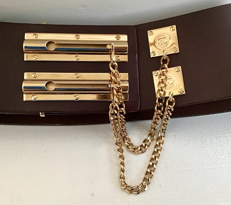 Chanel Brown Leather Sliding Chain Lock Belt. Featuring two gold toned sliding chain locks with Chanel logo. Size 38.