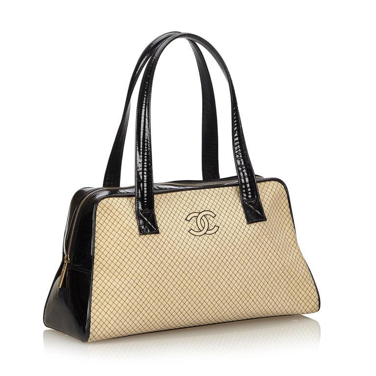 7e1aa2e7384 This shoulder bag features a quilted wool body with patent leather panels,  flat patent leather