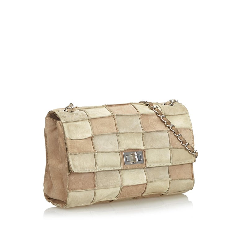 f5e6337bbadd The Reissue Patchwork Flap shoulder bag features a suede patchwork body, a  silver-tone