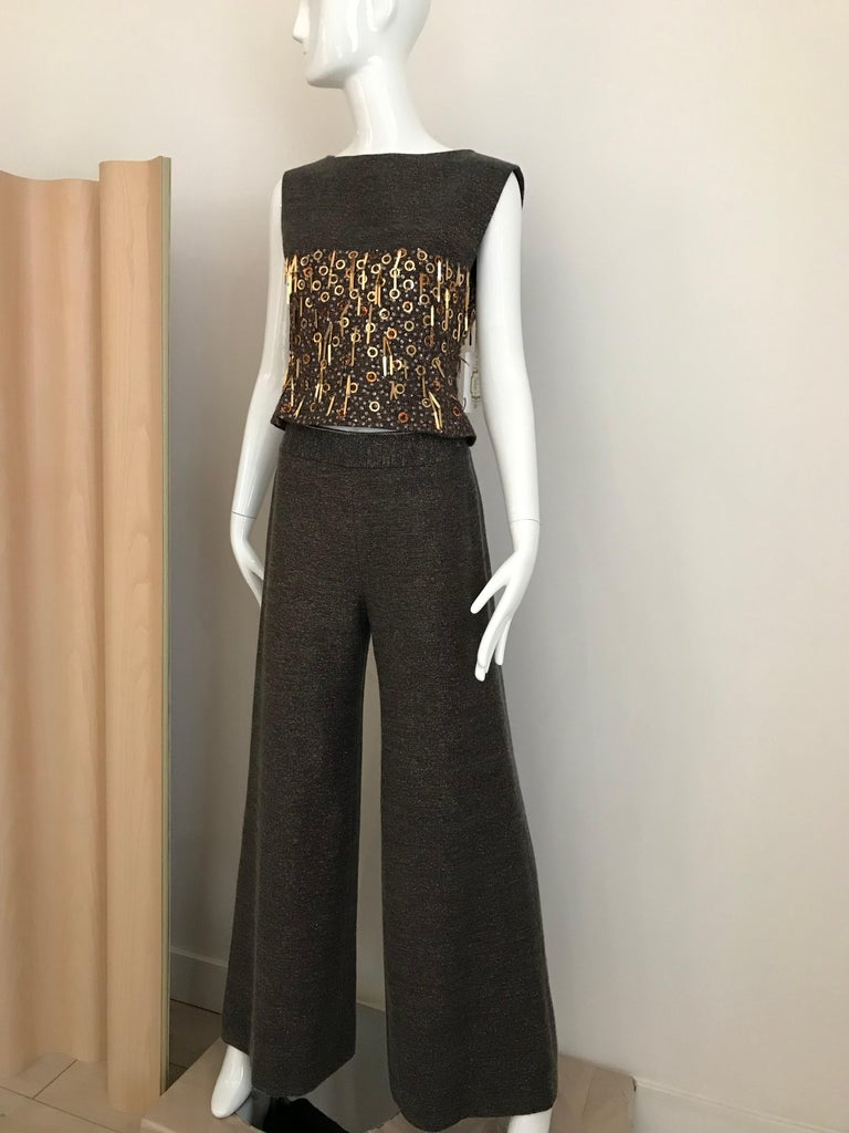 2000 Chanel  brown wool lined in silk with gold and bronze Pailletes. Top measurement: Bust: 32 inches/  waist: 28 inches Pant waist: 26 inches/ Hip: 38 inches/ Pants length: 43.5 inches