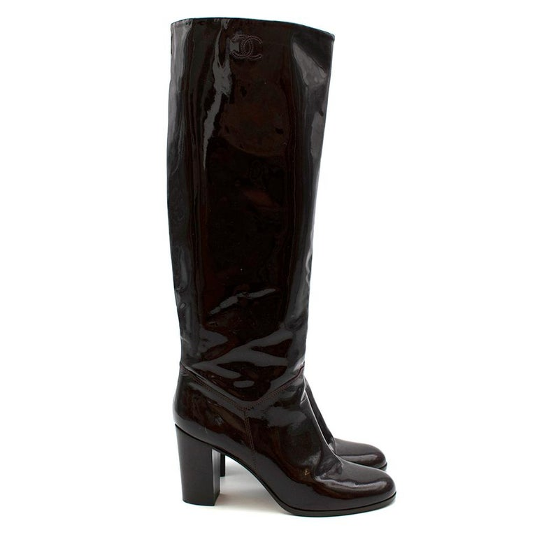 Chanel Burgundy Patent Leather Boots  - Knee high  - Pull on style - Tonal Embroidered CC  - Block Heel with CC branding at sole  - Patent leather outer  - Rounded toe  Made in Italy  Measurements: Approx.  Heel Height 9cm Height 51cm Insole