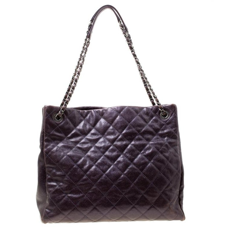 You will love carrying this fabulous tote from Chanel for your special outings. The burgundy tote is crafted from leather and features the everlasting quilted pattern on the exterior. It flaunts dual chain and leather interwoven handles and the