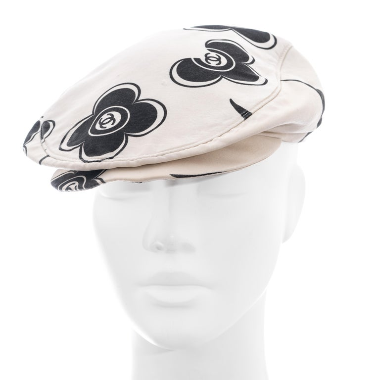 ▪ Chanel white and black flat cap ▪ Designed by Karl Lagerfeld  ▪ 100% Silk  ▪ Floral design with 'CC' logos  ▪ Size Medium ▪ Spring-Summer 2002