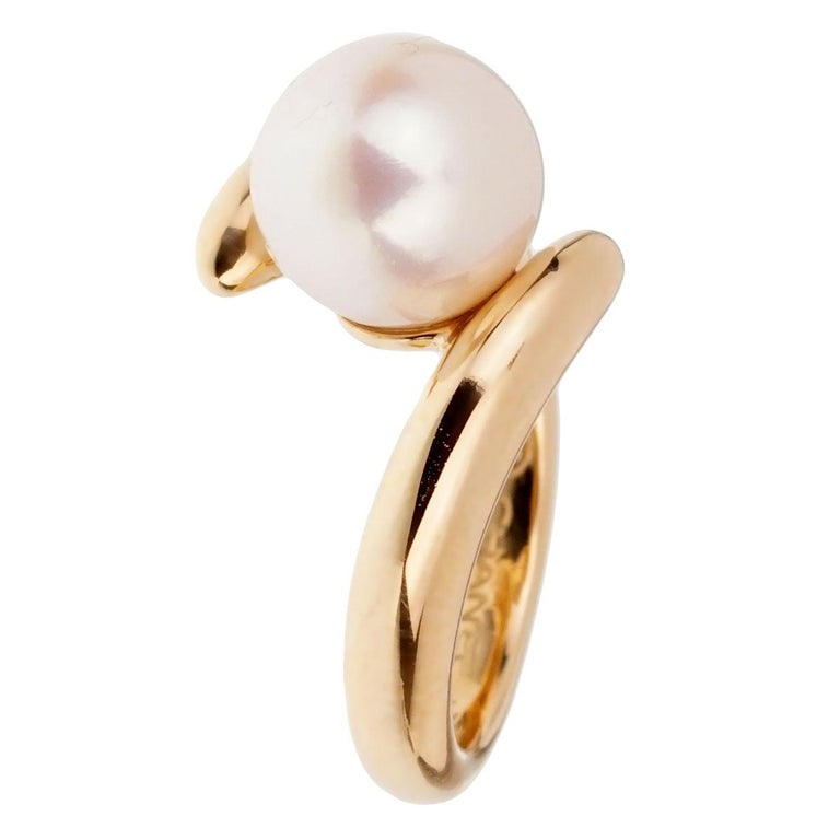 A chic bypass ring by Chanel crafted in 18k yellow gold.  Size 4 1/2 (Resizeable)