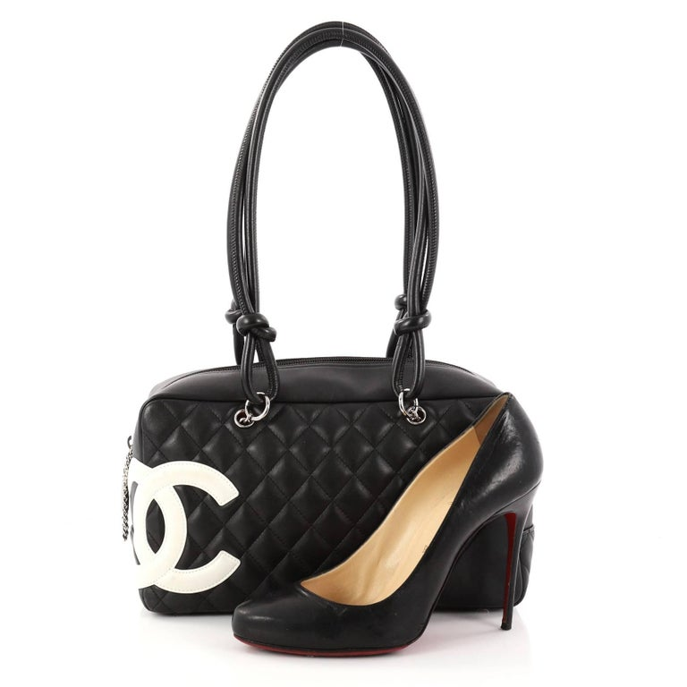 2b514febce This authentic Chanel Cambon Bowler Bag Quilted Leather Medium is a chic  and stylish bag from