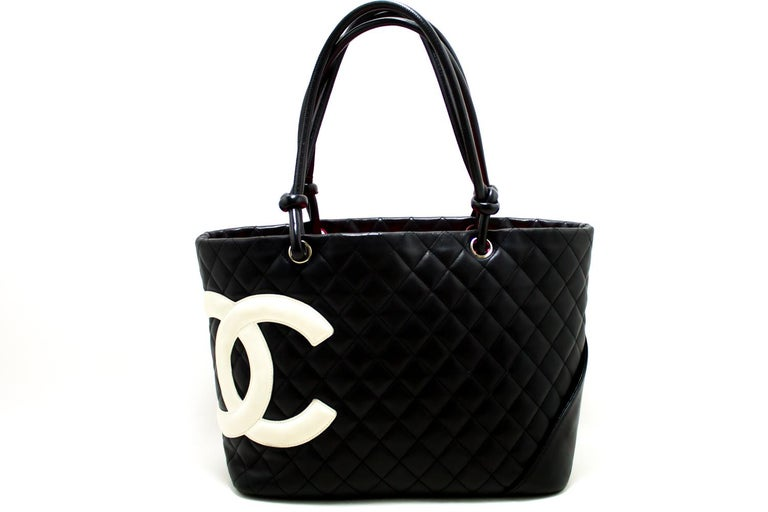 b672c2ac151a6 An authentic CHANEL Cambon Ligne Tote Large Shoulder Bag Black White  Quilted Calfskin. The color
