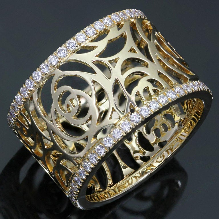 This splendid Chanel band from the elegant Camelia Ajoure Rose collection features the iconic floral openwork design crafted in 18k yellow gold and accented with round brilliant D-F VVS1-VVS2 diamonds. Made in France circa 2010s. Measurements: 0.38